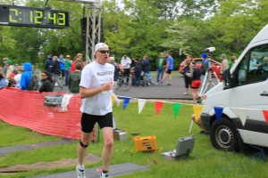 """Here's a shot of me crossing the finish line in my """"Relentless"""" Team in Training shirt at the Green Bay Triathlon last month."""